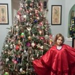 Girls wearing red on christmas tree