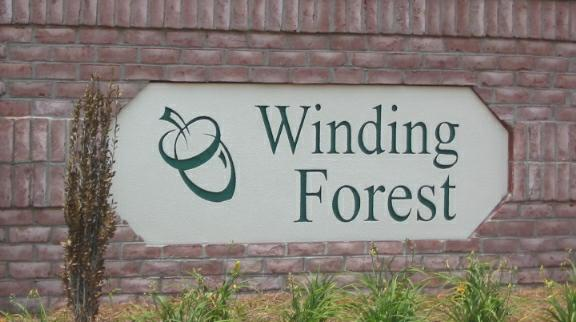 winding forest sign